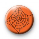 Bright Orange Spooky Spiders Web badge