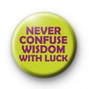 Never Confuse Wisdom With Luck badge
