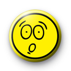 Shocked yellow smiley face badge